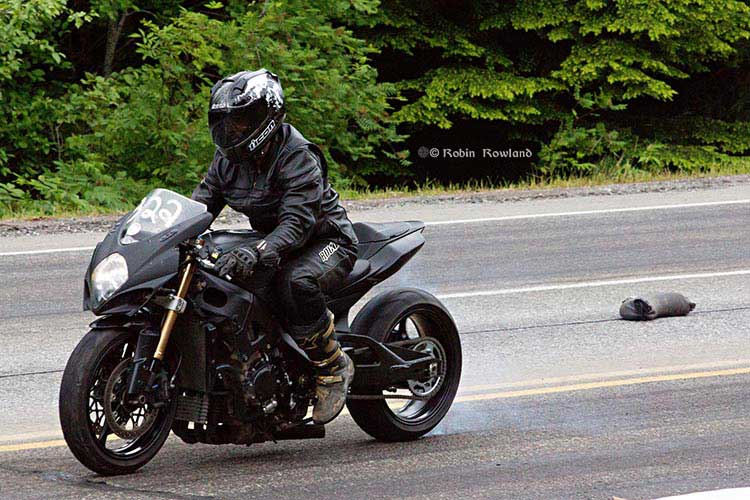 "Kitimat Hill Climb drag race,  2012; the spectacle of  ""sleds""  – snowmobiles on asphalt"