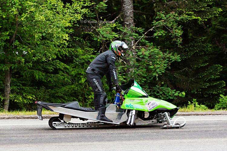 Sleds Asphalt snowmobiles return down the hill