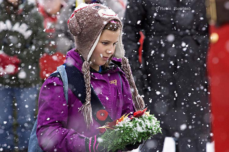 A Kitimat tradition,  children lay wreaths on Remembrance Day