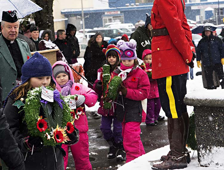 Children lay wreaths at the Kitimat cenotaph