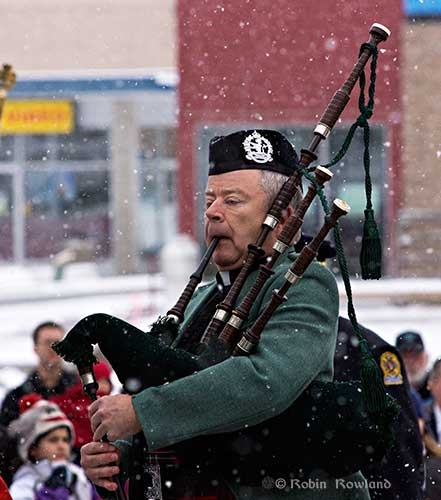Larry Scott plays the bagpipes