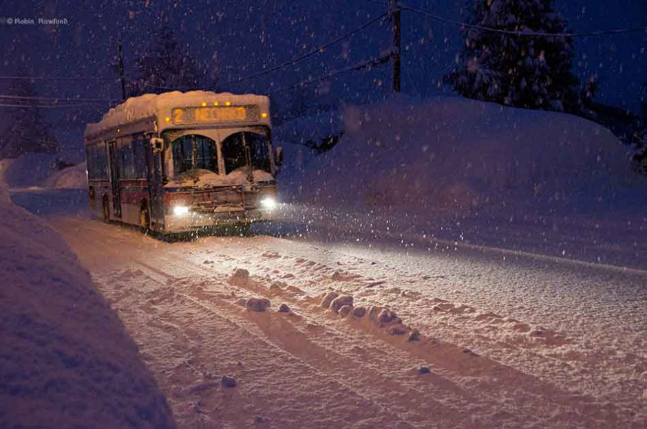 A morning bus makes it through heavy snow just before dawn  in Kitimat. BC, Jan. 24, 2012, Between Jan 20 and Jan 24, Kitimat received 162 centimetres of snow (63 inches)  (Robin Rowland)