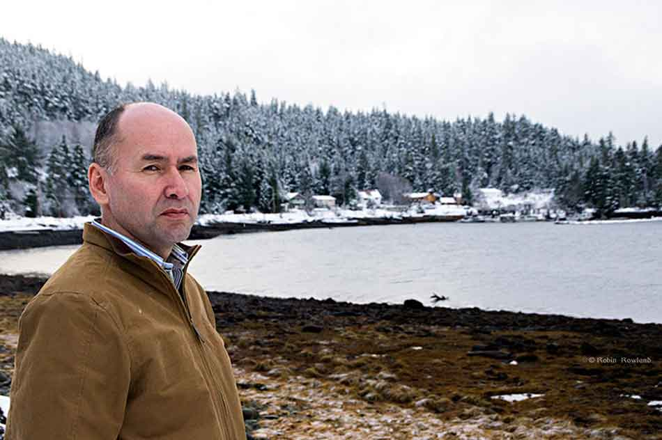 Ellis Ross, Chief Counsellor the Haisla Nation, on the shores of Douglas  Channel with the  Kitamaat Village dock in the background, Kitamaat Village,  BC,  Dec. 18, 2012. (Robin Rowalnd, shot for The Globe and Mail)