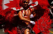 A man festooned in feathers with a Canadian maple leaf flag theme marches in Toronto's annual Pride Parade on June 24, 2007. It's estimated one million people took part in the parade and other festivities.  (Robin Rowland, shot for CBC News)