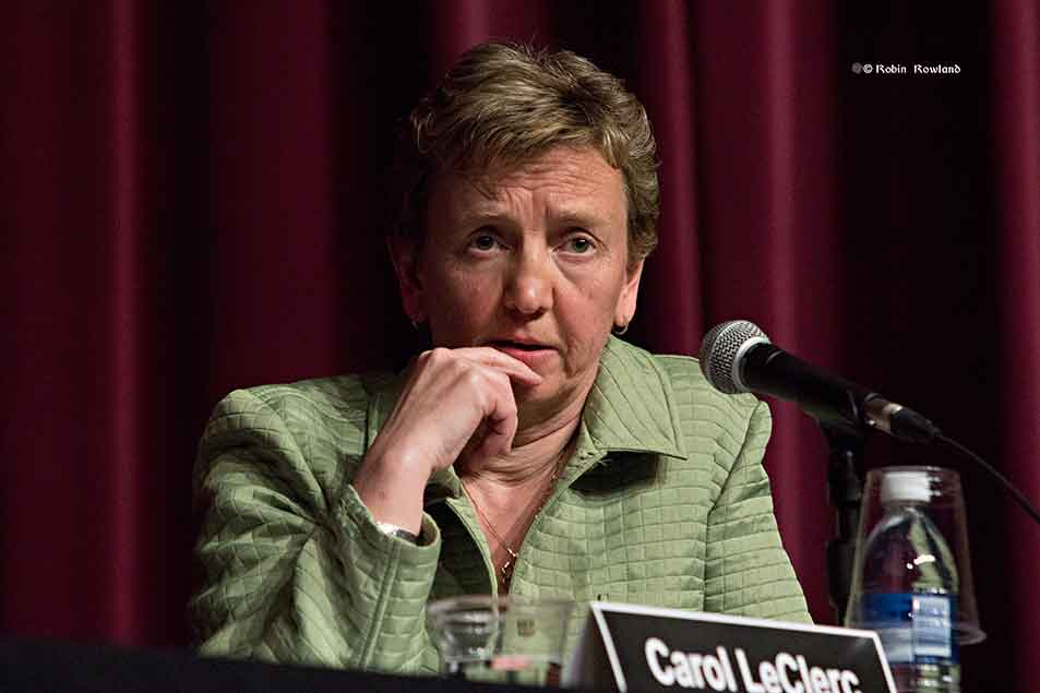 Carol Leclerc listens to question