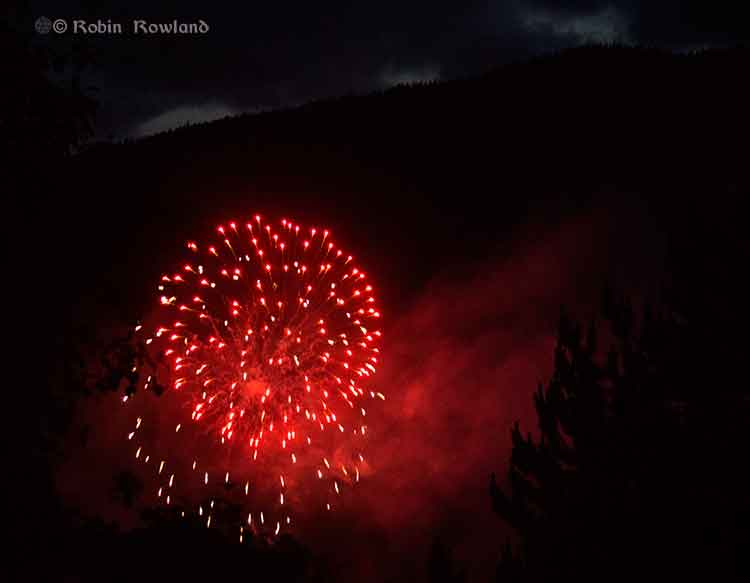 Fireworks in front of mountains