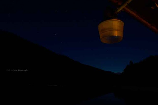 Overhead lamp on balcony and stars at night at Clio Bay. (Robin Rowland)