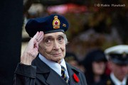 Merle Archer salutes at the Remembrance Day ceremony