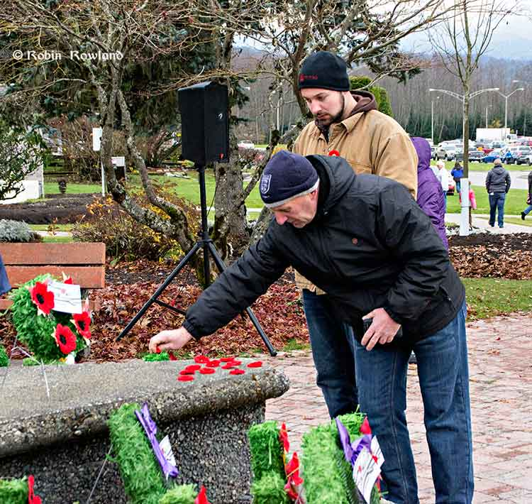Leaving poppies at the cenotaph
