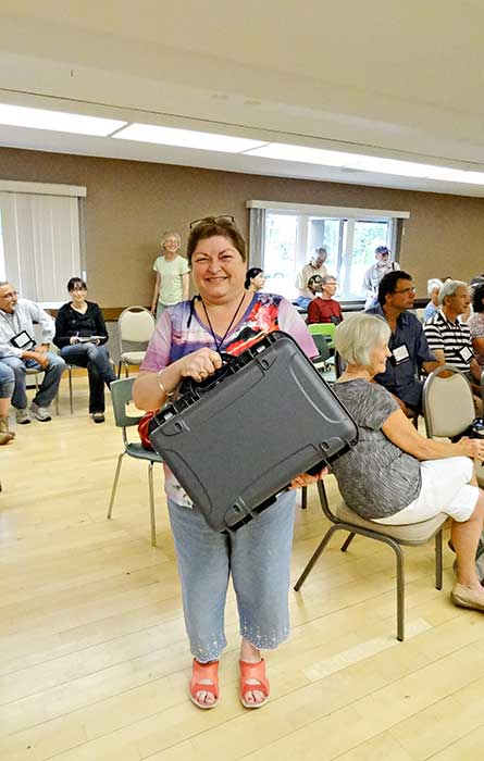 Darlene Tait won the grand door prize, a large Nanuk outdoor case. (Walter McFarlane)
