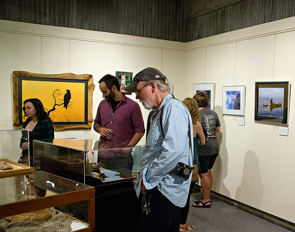 Guest speakers Paul Colangelo and Andy Clark look at museum exhibits during the opening of the North West Photo Fest exhibit at the Kitimat Museum & Archives, August 5, 2016. (Robin Rowland)