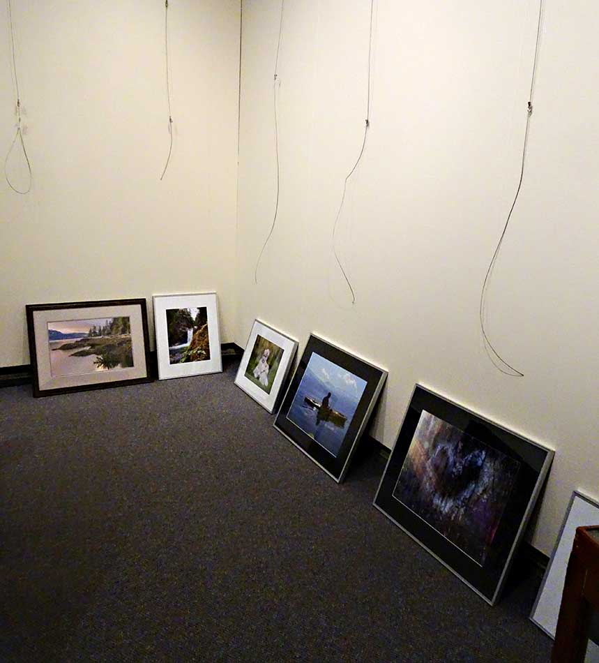 Preparing to hang the pictures at the Kitimat Museum & Archives. (Robin Rowland)