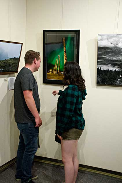 Viewers at the North West Photo Fest exhibit opening. (Robin Rowland)
