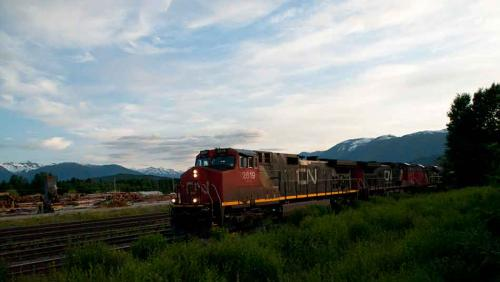 A 179-unit  intermodal container train enters the CN yards at Terrace, BC, as the sun sets, July 11, 2011. The eastbound train was loaded with  containers at the port of Prince Rupert, which is a major gateway for North America .(Robin Rowland)