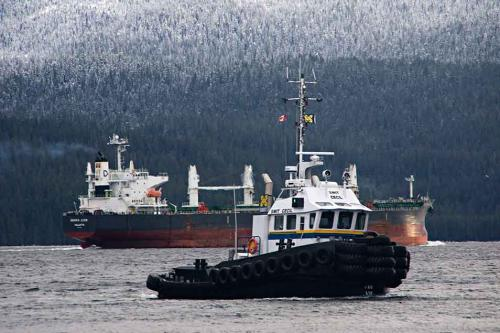 The 31,000 tonne Cypriot-flagged bulk carrier Densa Lion is seen leaving the Kitimat, BC, harbour, assisted by the tug Smit Cecil,  on  Dec 15, 2012. (Robin Rowland)