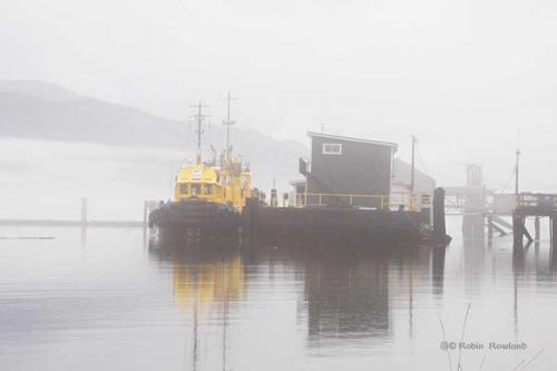 A Smit tug is tied up in Kitimat during fog on October 9, 2015.