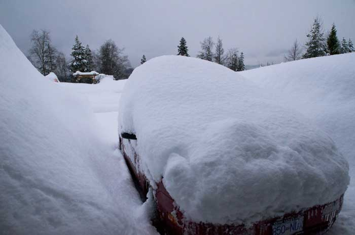 Snow covered car Jan 23